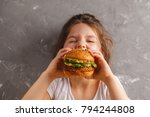 the little girl is eating a... | Shutterstock . vector #794244808