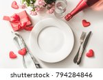 Stock photo valentines day dinner with table place setting with red gift glass for champagne a bottle of 794284846