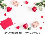 Stock photo valentine s day frame made of rose flowers gifts candles confetti on white background 794289478