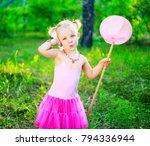 happy little girl wearing a... | Shutterstock . vector #794336944