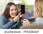 happy girl showing a blank... | Shutterstock . vector #794338369