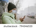 a woman stands near a road in... | Shutterstock . vector #794346520
