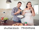 happy couple eating pizza... | Shutterstock . vector #794349646