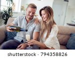beautiful couple is drinking... | Shutterstock . vector #794358826