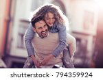 happy young couple having fun... | Shutterstock . vector #794359924