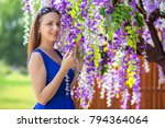 young girl in blue dresses... | Shutterstock . vector #794364064