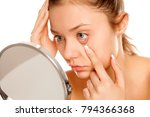 young girl checking her eyes in ... | Shutterstock . vector #794366368