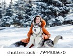 girl playing with a dog in the... | Shutterstock . vector #794400670
