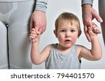child and parents  holding... | Shutterstock . vector #794401570