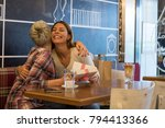 two young women having a great... | Shutterstock . vector #794413366