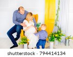 happy family in anticipation of ... | Shutterstock . vector #794414134
