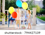 little boy and girl having fun... | Shutterstock . vector #794427139
