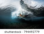 young surfer dives under the... | Shutterstock . vector #794492779