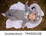 cute baby dressed in a romper...   Shutterstock . vector #794500138