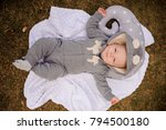 sweet baby dressed in a romper... | Shutterstock . vector #794500180