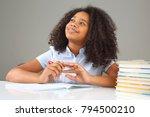 schoolgirl is thinking about... | Shutterstock . vector #794500210