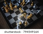 gold and silver chessmen on... | Shutterstock . vector #794549164