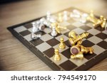 gold and silver chessmen on... | Shutterstock . vector #794549170