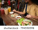 cropped image of couple eating... | Shutterstock . vector #794550598
