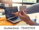businessman holding credit card ... | Shutterstock . vector #794557939