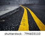 detail of curved double yellow... | Shutterstock . vector #794603110