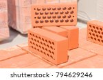 several red perforated bricks... | Shutterstock . vector #794629246