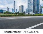 empty asphalt road with city... | Shutterstock . vector #794638576