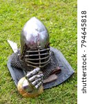 Small photo of knight's helmet and glove