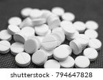 white pills on black background ... | Shutterstock . vector #794647828