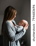 happy young mother with newborn ... | Shutterstock . vector #794683696
