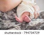 young woman cuddles her newborn ... | Shutterstock . vector #794734729
