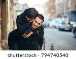 young man giving girlfriend... | Shutterstock . vector #794740540