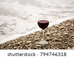 a glass of red wine on the... | Shutterstock . vector #794746318