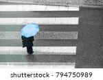 person walking on city street...   Shutterstock . vector #794750989