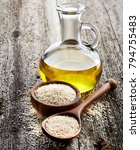 sesame oil with seeds on wooden ...   Shutterstock . vector #794755483
