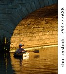 Small photo of Oxford, United Kingdom - September 08 2004: A Canoeist takes a breather on the River Thames