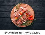 raw kebab from meat on a wooden ... | Shutterstock . vector #794783299