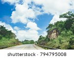 road crossing the forest with... | Shutterstock . vector #794795008