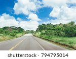 road crossing the forest with... | Shutterstock . vector #794795014