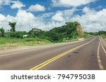road crossing the forest with... | Shutterstock . vector #794795038