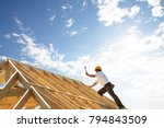 Male Roofer Carpenter Working...