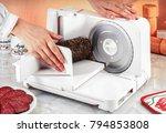 hands of a woman sling a salami ... | Shutterstock . vector #794853808
