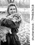 Woman Pet Owner With Blue Coat...