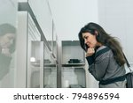 young woman in museum watching... | Shutterstock . vector #794896594