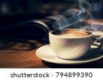cup of coffee in cafee in dark... | Shutterstock . vector #794899390