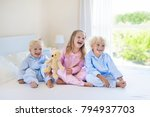 kids playing in parents bed.... | Shutterstock . vector #794937703