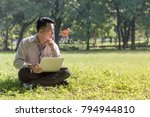 businessman sitting on the lawn ... | Shutterstock . vector #794944810