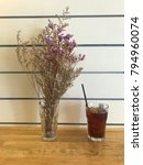 Small photo of Iced americano with dried violet lavender vase