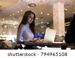 Small photo of Young beautiful female student, write school paper or freelancer works on project at cafeteria or coworking hub, writes code for startup company, successful woman empowered and independent