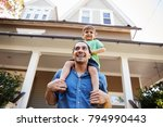 father giving son ride on... | Shutterstock . vector #794990443